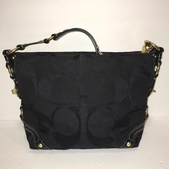 739c7ee2a235 Coach Handbags - Coach Black Signature Canvas Carly Bag